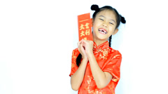 Happy little Asian Chinese child in traditional dress - stock footage