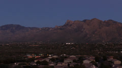 Time lapse: Full moon rising over Santa Catalina mountains, Arizona Stock Footage