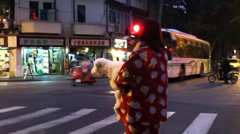 Woman in Shanghai, China in Pajamas on Sidewalk With Dog Stock Footage