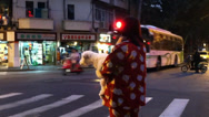 Stock Video Footage of Woman in Shanghai, China in Pajamas on Sidewalk With Dog