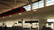Stock Video Footage of People Mover Train Runs Inside Terminal at Detroit Metro Airport