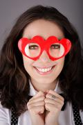Girl with Heart-Shaped Glasses - stock photo