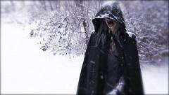 Wraith Materializes | horrific hooded figure in snow - stock footage