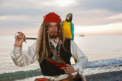 pirate with  a parrot - stock photo