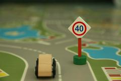 "Mini wooden road sign ""speed limit 40"" Stock Photos"