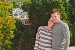young couple on the background of a beautiful home - stock photo