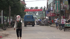 A busy street in rural China Stock Footage
