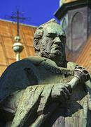 poland, krakow, statue of josef dietl in front of franciscan church - stock photo