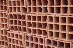 a row of hollow clay bricks - background - stock photo