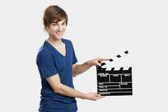 holding a clapboard - stock photo