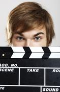 showing a clapboard - stock photo
