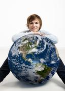 Young man over the earth Stock Photos