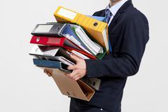 business man carrying folders - stock photo