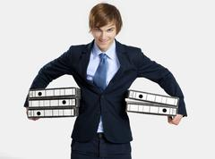 business man carrying folders - stock photo