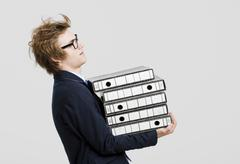 Business man carrying folders Stock Photos
