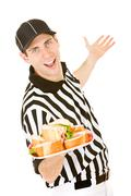 Referee: holding plate of sandwiches Stock Photos