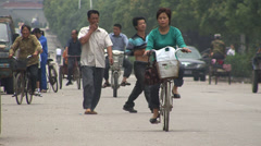 Local people in rural China riding bikes Stock Footage