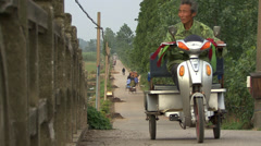 Villagers on a rural Chinese road Stock Footage