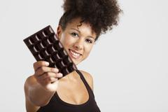 woman with a chocolate bar - stock photo