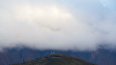 Timelapse of fast moving clouds and fog over distant hills Stock Footage