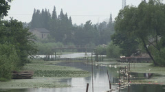 A river in a rural Chinese village near Yangzhou, China Stock Footage