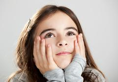 Little girl thinking Stock Photos