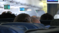 Passenger view inside the cabin of a commercial airline. Stock Footage