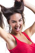 Woman grabbing her hair Stock Photos