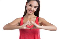 making  a heart symbol with hands - stock photo