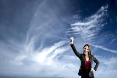 Business woman throwing a paper plane Stock Photos