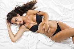 Sexy woman with a black lingerie Stock Photos