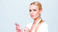 Blond Business Woman Using Mobile Phone - stock footage