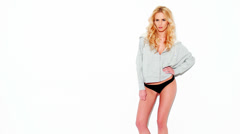 Blond Lady in Sweatshirt and Panties Posing on White - stock footage