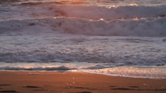 Waves sunset beach reflection Stock Footage