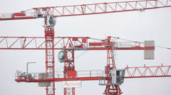 Three tower cranes on building site in London - stock footage