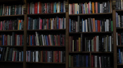 University Library Bookshelf Pan Right Stock Footage