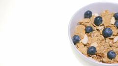 Breakfast cereal with fresh blueberries - stock footage