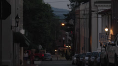 People walking downtown summer evening Stock Footage