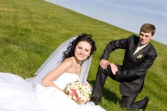 Rest of newly-married couple in the park Stock Photos