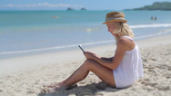 Stock Video Footage of Caucasian woman on beach vacation using tablet pc