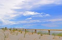Beach fence with beautiful blue skies Stock Photos
