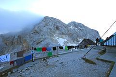 Mountain hut on Triglav - stock photo
