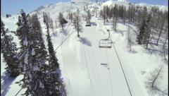 AERIAL: Ski lift in European Alps Stock Footage
