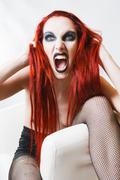 Expressive gothic woman with artistic makeup Stock Photos