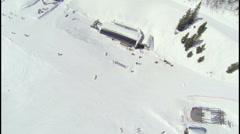 AERIAL: Skiers in ski resort Stock Footage