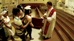 Woman receives Sacrament of Confirmation high angle Stock Footage