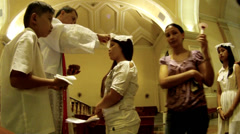 Woman receives Sacrament of Confirmation low angle Stock Footage