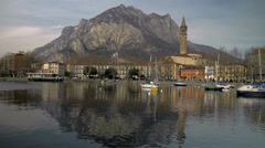 Lecco waterside with boats and mountains Stock Footage