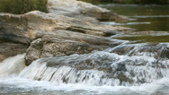 Stock Video Footage of Water stream running over the rocks in the fores