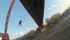 jump off the bridge and swinging pendulums - stock footage